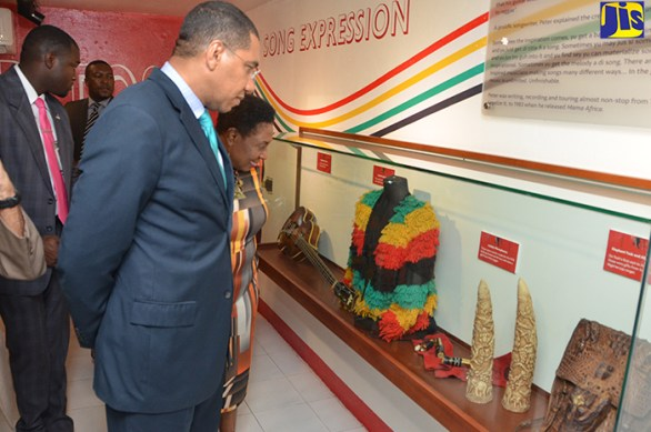 Prime Minister the Most Hon. Andrew Holness (right), and Minister of Culture, Gender, Entertainment and Sport, Hon. Olivia Grange, look at memorabilia on display at the opening of a museum honouring the life and work of late reggae icon Peter Tosh at the Pulse Centre, Trafalgar Road on October 19.