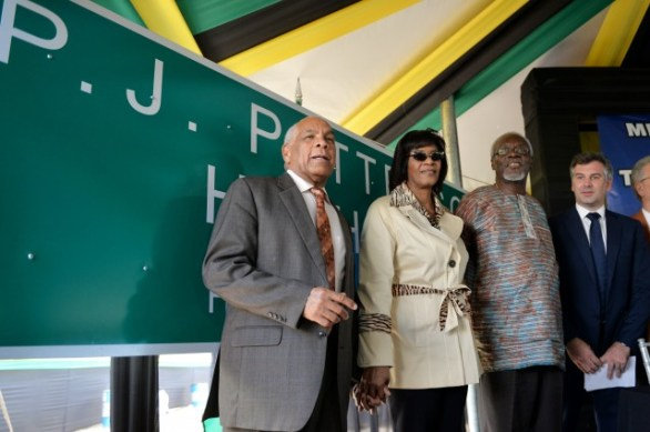 Prime Minister, the Most Hon. Portia Simpson Miller (2ndleft), and former Prime Minister, the Most Hon. P.J. Patterson (2nd right), along with Transport, Works, and Housing Minister, Dr. the Hon. Omar Davies (left), and Managing Director TransJamaican Highway, Guillaume Allain, stand in front of the sign bearing the new name of the Kingston to May Pen segment of Highway 2000, which was unveiled during Friday's (April 17) renaming ceremony, at the corridor's Old Harbour Interchange in St. Catherine. The 44-kilometre roadway, which has been renamed the P.J. Patterson Highway, is managed by TransJamaican Highway.