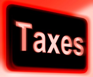 Taxes Sign Showing Tax Or Taxation