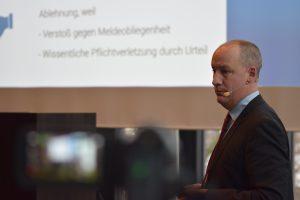 Marc Hinrichsen referiert zum Thema Versicherungsschutz für Versicherungsvermittler