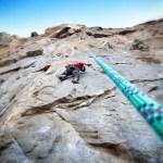 Joseph climbing a 10a route. My first sports outdoors climbing ever.
