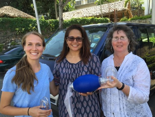 Hannah Bogard and Lena receive medical supplies from Michelle Hau'ofa from PNG Tribal Foundation.
