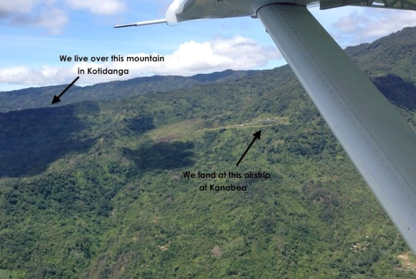 "View of Kanabea airstrip (4,100 feet elevation) that connects us with the outside world. We live ""just"" over the mountain from Kanabea."