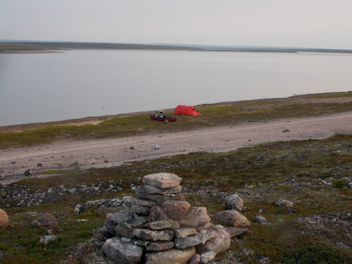 Camp, Illurjualik Narrows,  1km west of Qamanaarjuk Lake, caribou have been walking on the sandy gravel behind the tent