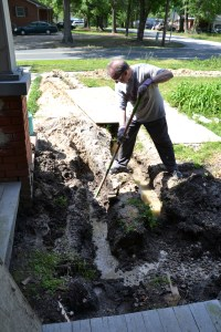 Scott prepares to install pipe.