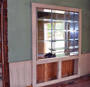 A glass cabinet hid the original door to the kitchen, visible here.
