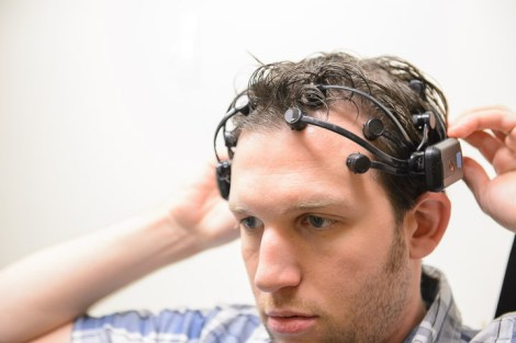 ASU educational technology doctoral student John Sadauskas demonstrates use of an EEG headset, one of three kinds of sensors helping researchers observe student behavior and physiological responses while using Facebook. The research project at the Learning Sciences Institute's Advancing Next Generation Learning Environments (ANGLE) Lab at ASU is overseen by Associate Professor Robert Atkinson.