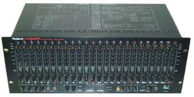 All-analogue 24-channel rack mixer from the early 90s.  They literally don't make them like this any more. Finally managed to track this one down in Denmark.  This isn't what I mix on, it's simply for monitoring purposes during recording. I've got it permanently hooked up to a 6-output headphone amp, so can work with large bands pretty easily.  The unit also features four effects sends and six stereo returns. This enables us to record clean signals while still monitoring any effects that are part of your normal live performance. This gives maximum flexibility for the mix stage without you having to change the way you play.