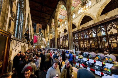 Real ale and cider drinkers and lines of barrels in the church