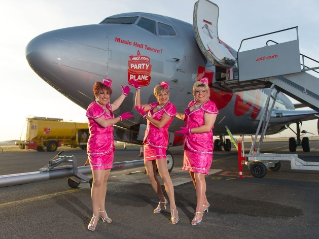 Paul and his fellow performers in front of the Jet2 plane