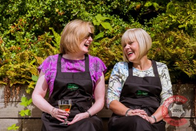 Two guests enjoying a joke over a glass of wine at the Kitchen Social