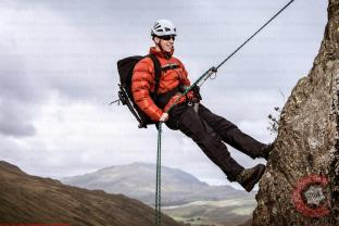 Commercial Photography Sports - A model abseiling in a down jacket