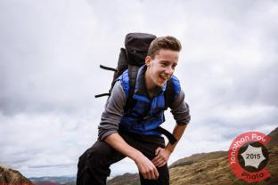 Commercial Photography Sports - A model walking in the Lakes with a backpack on