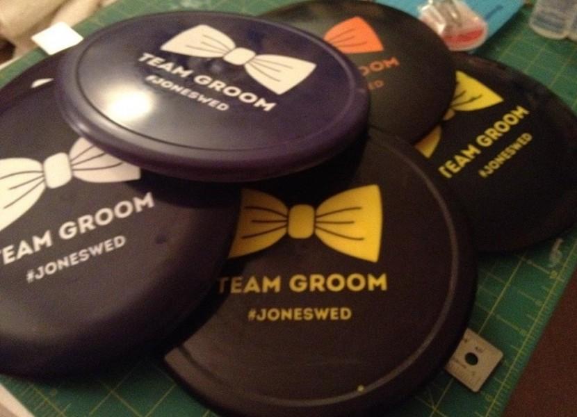 pile of custom team groom discs