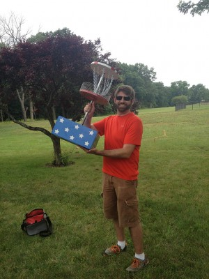 Winner, Christopher Jones holds the trophy from the 2013 Economy Open disc golf tournament.