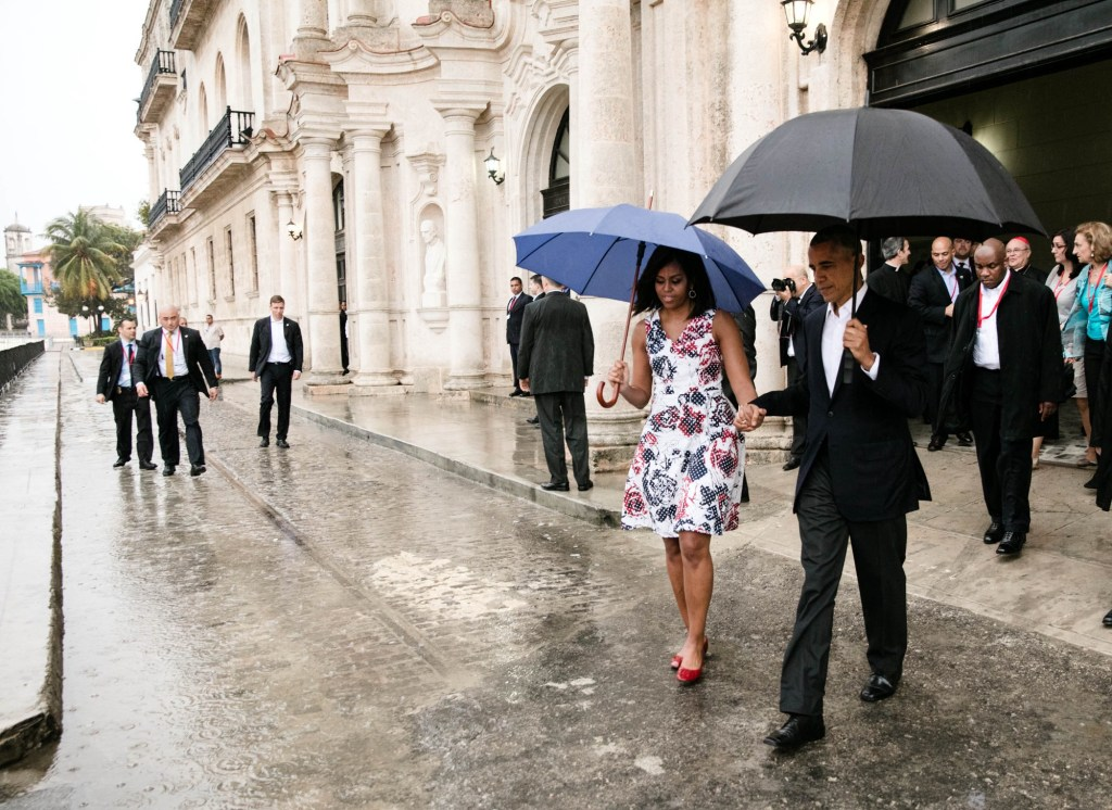 President Obama and First Lady Michelle Obama walk to the motorcade after touring Old Havana on Sunday. (Credit: Pete Souza/white House)