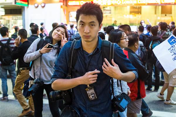 Anthony Kwan, a Hong Kong-based photojournalist, was arrested in August 2015 on charges of violating Thai law for possessing a bulletproof vest and helmet. (Courtesy of freekwan.org)