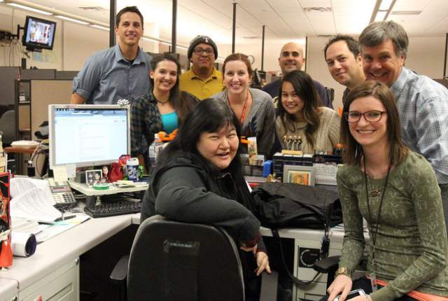 Review-Journal staffers gather around editor Lisa Kim Bach's desk on Nov. 20, 2014. Bach is in foreground. (Credit: (Kevin Cannon/Las Vegas Review-Journal)