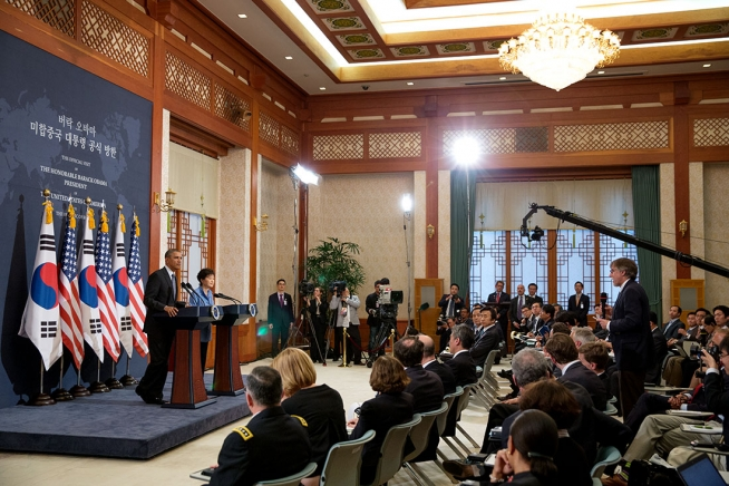 "President Obama and south Korean President Park Geun-hye held a joint press conference in Seoul on a 2014 trip to Asia. Howard French writes that as a correspondent in Japan for the New York Times, he learned that the Japanese office manager ""resented that the Times had sent a black man with an African wife to cover Japan, interrupting an endless line of white bureau chiefs."" (Credit: Pete Souza/ White House)"
