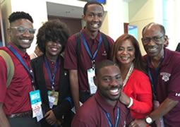 Morehouse College students went to Philadelphia to cover the Democratic National Convention. From left: Ugo Unigwe, DeShay Kidd (from Spelman College), Kingsley Iyawe, Donzaleigh Abernathy, adviser Ron Thomas. Ayron Lewallen is in foreground. Abernathy is the daughter of civil rights leader the Rev. Ralph David Abernathy. (Credit: Morehouse College)