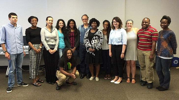 Members of the News Lab Class of 2015-16 in their classroom at Georgia State University. James Salzer, center, a reporter for Atlanta Journal-Constitution, center, recently taught the class about how to analyze campaign finance reports. (Credit: News Lab)