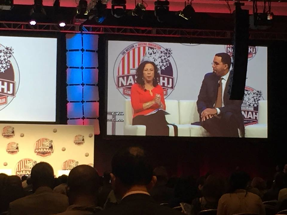 """Maria Hinojosa of """"Latino USA"""" moderates a session last week with Secretary of Education John King Jr. at the joint convention of the National Association of Black Journalists and National Association of Hispanic Journalists. Hinojosa said in a podcast Wednesday, """"if I see a story about a community that I understand, and I know well — oh, my God, I mean, that's a journalist's dream."""" (Credit: Sandra Gonzalez)"""
