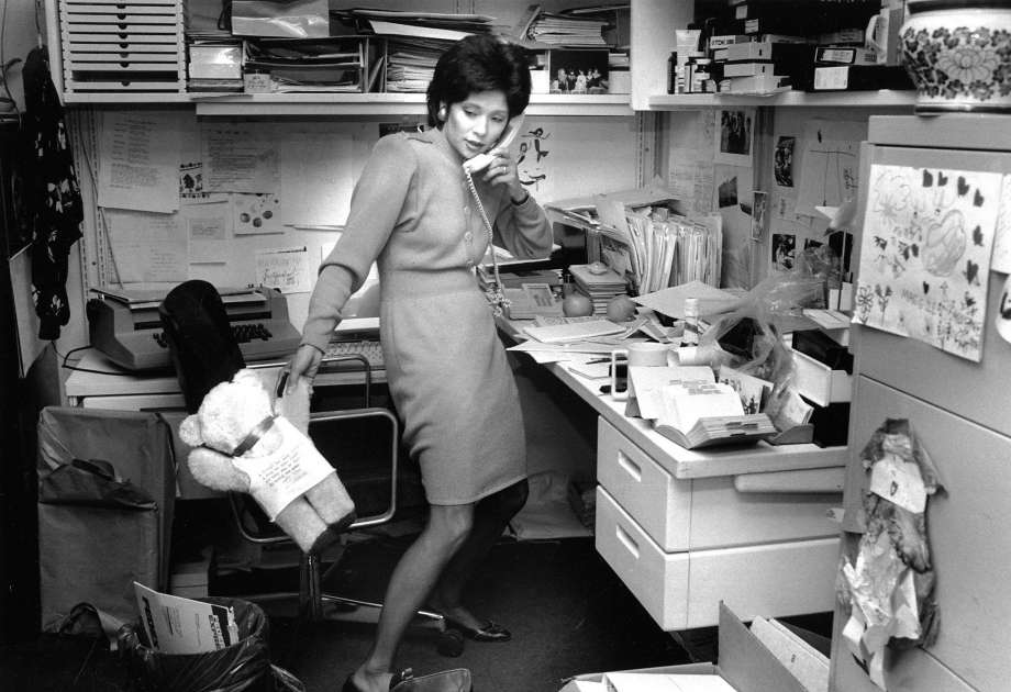 Wendy Tokuda works during a busy day at KPIX in 1990. According to the photo caption, she's returning calls, and the bear is from a young fan. (Credit: Liz Hafalia/San Francisco Chronicle)