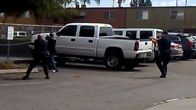 The police department in El Cajon, Calif., released this still from a witness' video, showing the slain Alfred Olango in confrontation with officers. In the protests that followed the shooting, people jumped a news cameraman, who said they stole a $15,000 camera, according to the San Diego Union-Tribune.