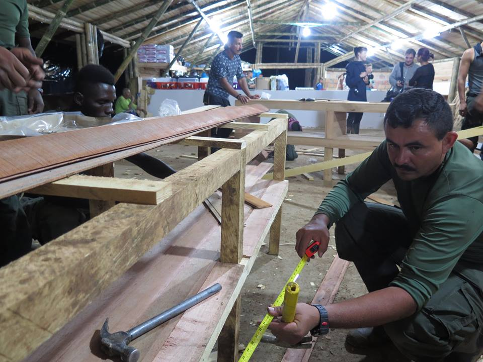""""""" Guerrillas quickly built, in a matter of days, a virtual hamlet, complete with meeting halls, houses for FARC chieftains, press rooms and an elaborate stage. """" (Credit: Juan Forero)"""