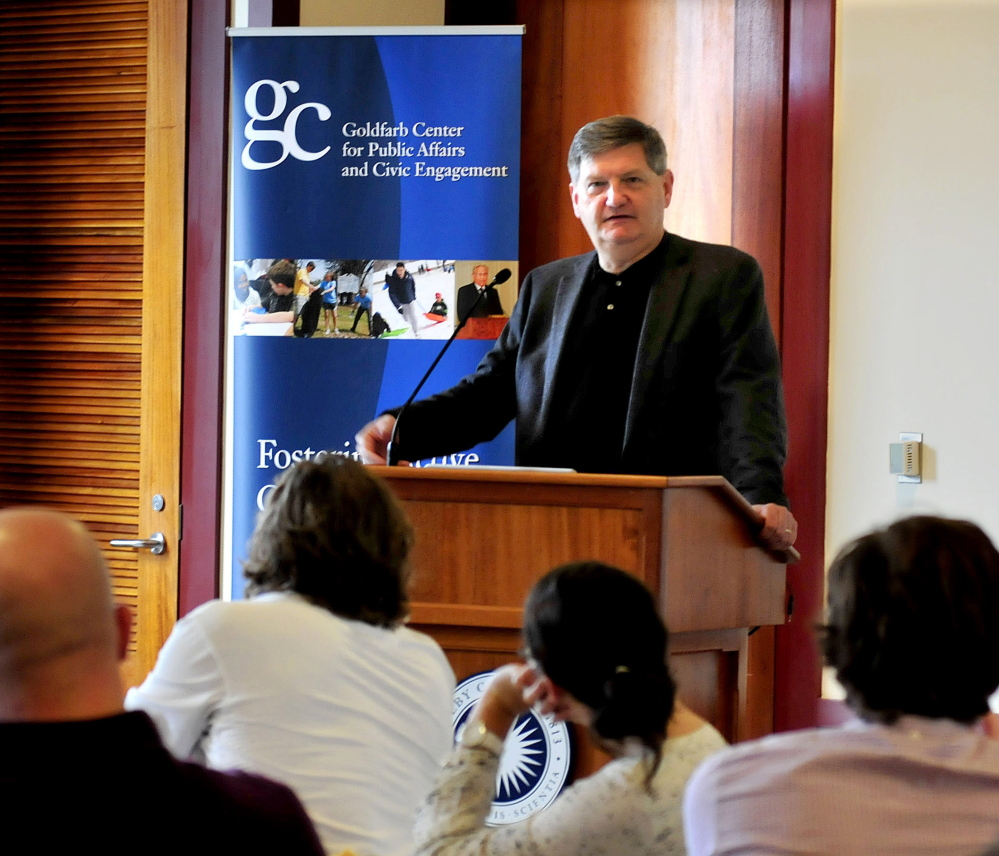 New York Times reporter James Risen speaks with students at Colby College in Waterville, Maine, in 2014. He won the Elijah Parish Lovejoy Award for courageous journalism. (Credit: David Leaming/Morning Sentinel)