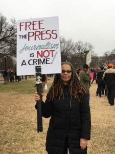 As press secretary Sean Spencer was berating the press corps at the White House on Saturday, documentarian June Cross, a Columbia Journalism School professor, carried a sign outside. (Courtesy June Cross)