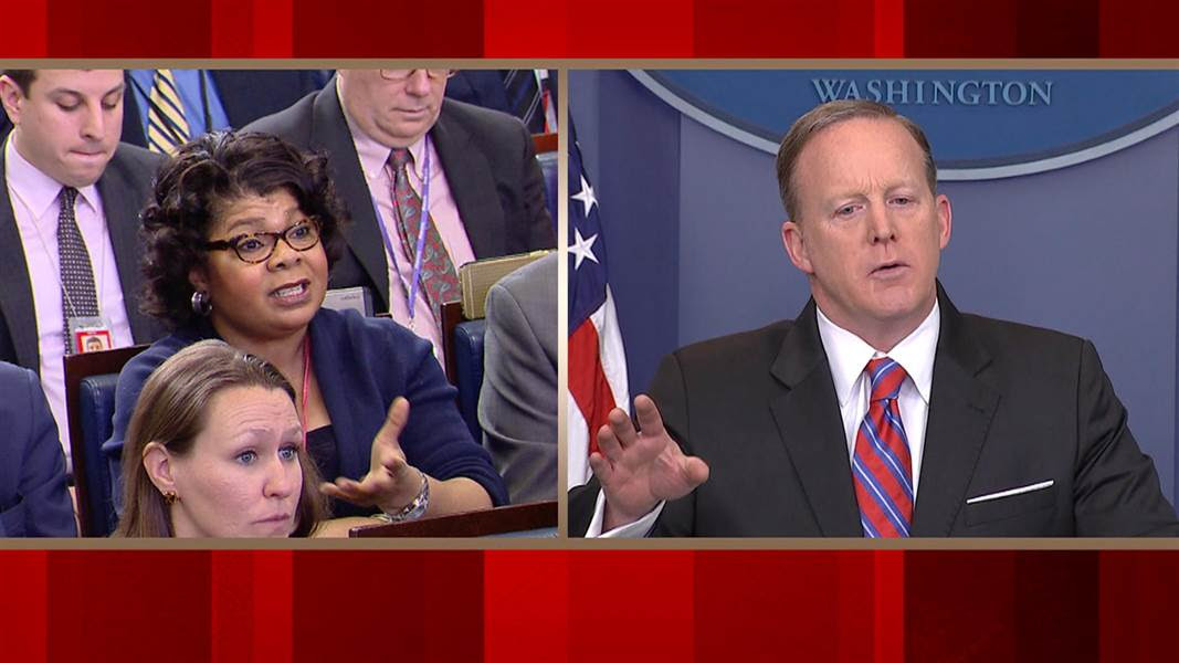 "April Ryan, left, asks White House Press Secretary Sean Spicer, right, what the administration does to revamp its image. He asked her, ""please stop shaking your head."" (Credit: CNN)"