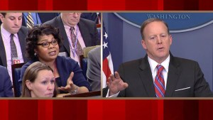 "In March, April Ryan, left, asked White House Press Secretary Sean Spicer, right, what the administration does to revamp its image. He asked her, ""please stop shaking your head."" (Credit: CNN)"