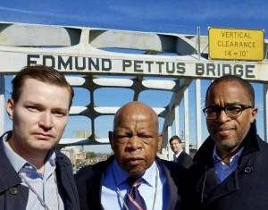 Rep. John Lewis, D-Ga., center, with Jonathan Capehart, right, and his husband Nick Schmit on the Edmund Pettus Bridge on March 4. (Credit: Jonathan Capehart)