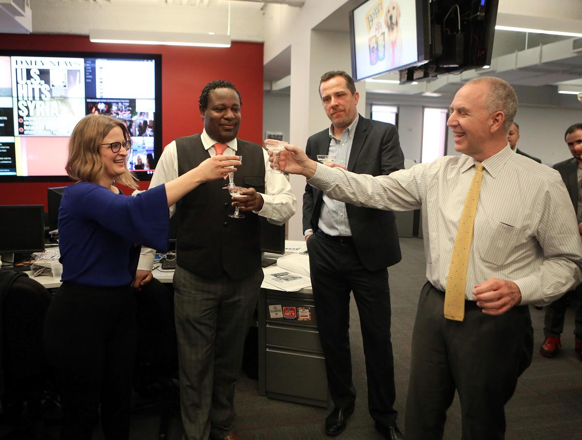At the Daily News in New York, Sarah Ryley celebrates receiving a Pulitzer Prize with Head of News Robert Moore, former editor-in-chief Jim Rich and Editor-In-Chief Arthur Browne. (Credit: Jefferson Siegel/Daily News)