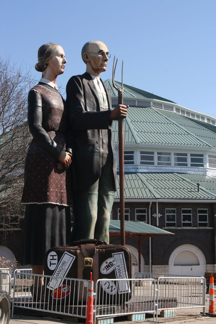 "Seward Johnson's ""God Bless America"" statue, 25 feet tall and 5,900 pounds, depicts Grant Wood's ""American Gothic."" (Credit: iowastatefair.org)"