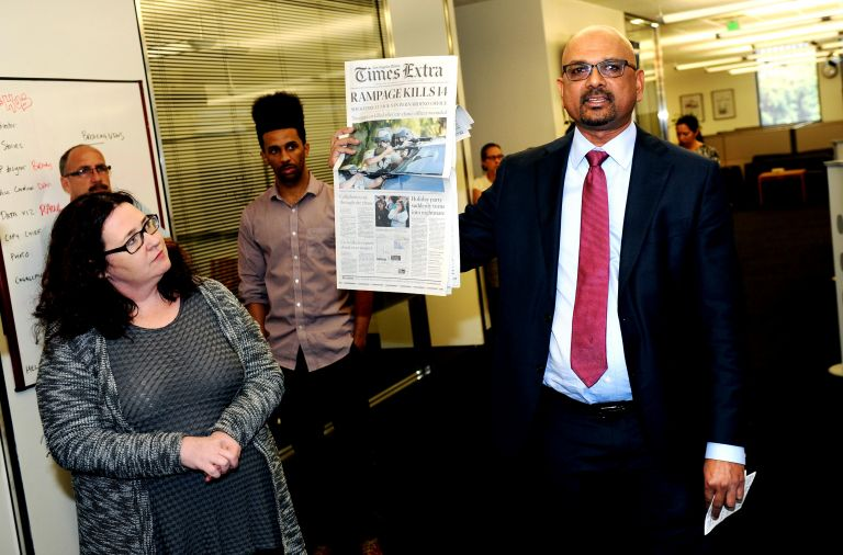 Davan Maharaj, editor and publisher of the Los Angeles Times, announces the Pulitzer prize to reporters and editors in 2016. (Credit: UC Riverside)