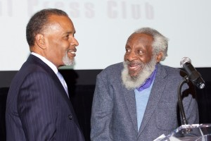Dick Gregory, right, introduces honoree Joe Madison of Sirius XM at a Capital Press Club gala in Washington in 2014. (Credit: Capital Press Club)