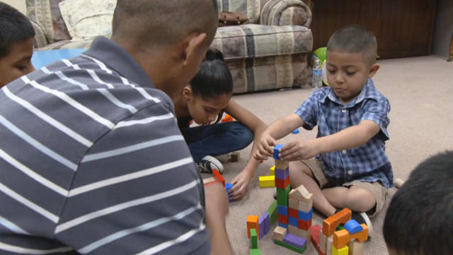 Jesus Berrones is living inside the Shadow Rock United Church of Christ in Phoenix while fighting deportation. His five-year-old son, Jayden, is battling leukemia. (Credit: CBS News)