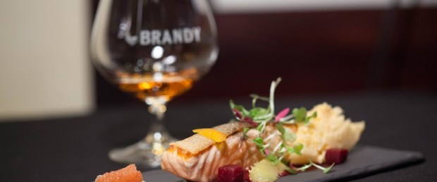 Seared Scottish Salmon with Citrus, blood orange sponge, fennel, butarga, cured egg served with Oude Meester 12 Year Old