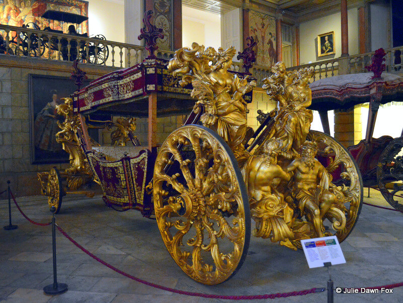 18th century coach with elaborate statues and finishings