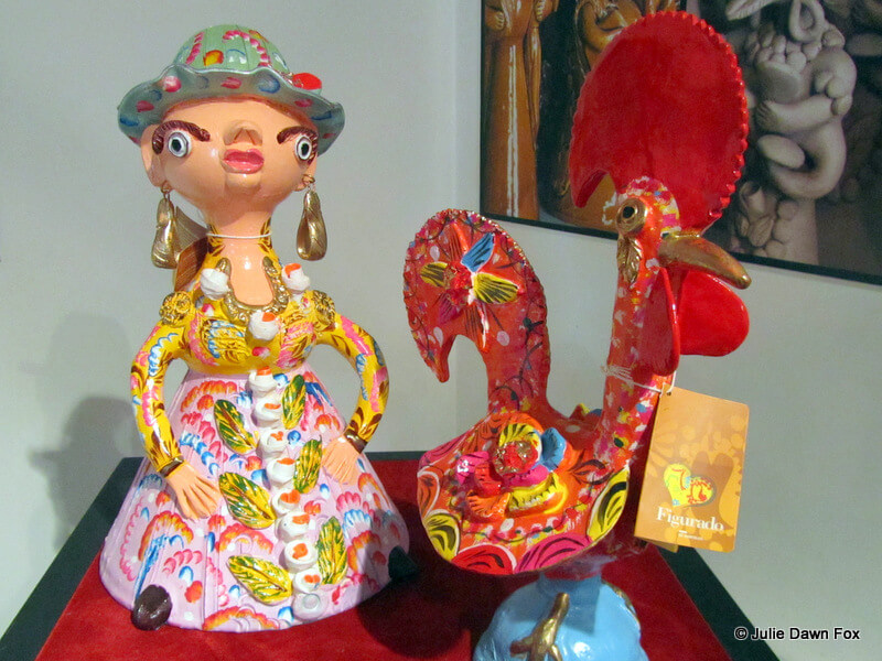 Typical ceramic figurines from Barcelos include heavy-browed women and cockerels.