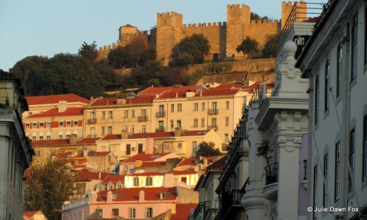 St. George's castle and buildings in golden sunlight, Lisbon