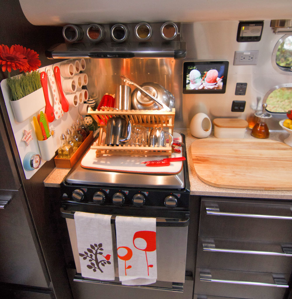 peek inside rv kitchen cabinets Inside an Airstream Travel Trailer Airstream Travel Trailer Modern Interiors Decorating a Trailer