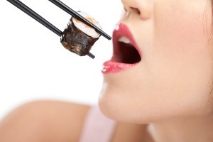 bigstock-Beautiful-girl-holding-sushi-w-33293702-300x200