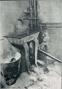 Hall sink in Washington Street tenement, 1914