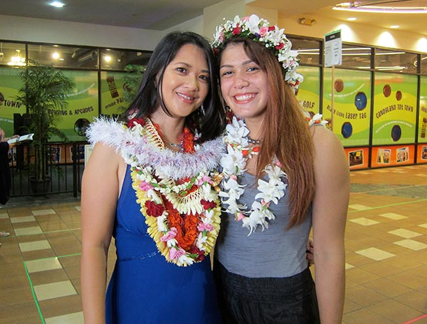 "Bassford (left) celebrates with documentary subject Teshya Alo at the premiere of ""Winning Girl"" at the 2014 Hawai'i International Film Festival - Courtesy of Kimberly Bassford"