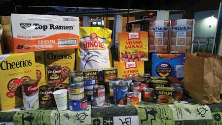 ASUH officers asked participants to bring in two canned foods to help refill the campus food pantry – Courtesy of Ka'ahu Alo