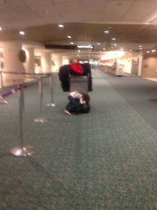 child asleep in airport