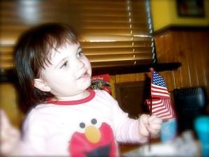 child holding us flag